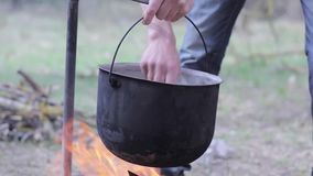 Vegetable soup outdoors in a cauldron stock footage