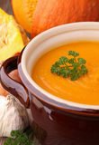 Cooking pot with pumpkin soup Stock Photo