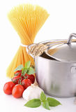Cooking pot, spaghetti and ingredient. Cooking pot with spaghetti, tomato and garlic on white background royalty free stock photo