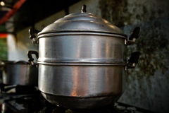 Cooking pot. Steam over cooking pot in kitchen Royalty Free Stock Photo
