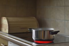 Cooking pot on stove. Cooking, Photograph of a pot in the stove, kitchen at home royalty free stock photo