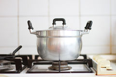 Cooking pot on stove Stock Photography