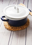 Cooking pot on white wooden table. Kitchen equipment. Royalty Free Stock Photos