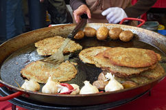 Cooking potato pancakes in the street of Cesky Krumlov Stock Photo