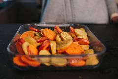 Cooking potatoes and sweet potatoes royalty free stock photography