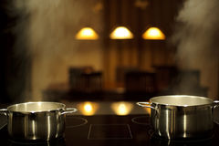 Cooking with pots Royalty Free Stock Photography