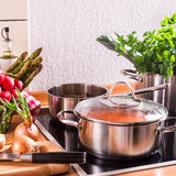 Cooking pots on the stove Stock Photos