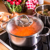 Cooking pots on the stove Stock Photo