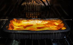 Cooking premade lasagna in the oven Royalty Free Stock Photo