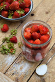 Cooking preparation of compote or jam from strawberry. Homemade conservation with organic fresh berry for the winter. Fruit desser Stock Photography