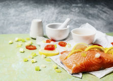 Cooking preparation with piece of salmon  fish with lemon Royalty Free Stock Photo