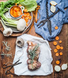Cooking preparation of raw meat roast with vegetables and fresh condiment on rustic wooden background, top view stock photos