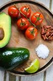 Cooking. Preparing popular mexican food guacamole royalty free stock photos