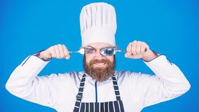 Cooking process concept. Lets try dish. Hungry chef ready to try food. Time to try taste. Chef happy smiling face hold. Spoon and fork. Man handsome with beard royalty free stock photo