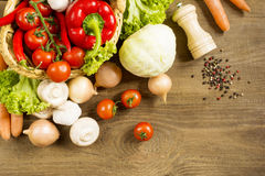 Cooking process in the kitchen products spread on the rough wooden table. Cooking process in the kitchen vegetables kitchen utensils laid out on the rough wooden Royalty Free Stock Image