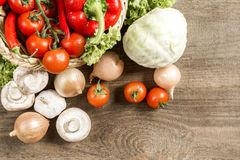 Cooking process in the kitchen. Vegetables kitchen utensils laid out on the rough wooden table top view Royalty Free Stock Image
