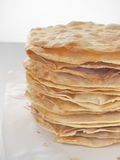 Cooking process. Preparing multi-layered cake. Crusts for homemade mille feuille. Big pile of fresh pancakes. Close up. Side view Stock Photo