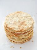 Cooking process. Preparing multi-layered cake. Crusts for homemade mille feuille. Big pile of fresh pancakes. Top view Stock Image