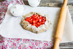 Cooking processes biscuit with fresh strawberries, healthy desse Stock Images
