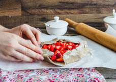 Cooking processes biscuit with fresh strawberries, vegan dessert Stock Photos