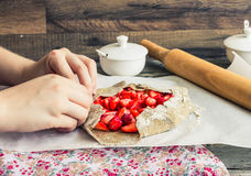 Cooking processes biscuit with fresh strawberries, vegan dessert Royalty Free Stock Images