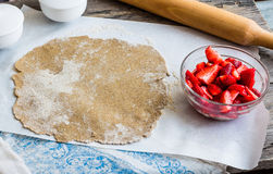 Cooking processes rye biscuit with fresh strawberries, healthy d Royalty Free Stock Photography