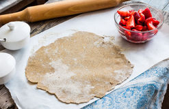Cooking processes rye biscuit with fresh strawberries, healthy d Royalty Free Stock Images
