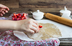 Cooking processes rye biscuit with fresh strawberries, healthy d Royalty Free Stock Photo