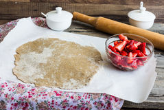 Cooking processes rye biscuit with fresh strawberries, healthy d Stock Photography
