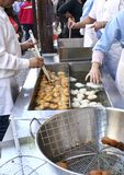 Cooking pumpkin fritters in Valencia, spain during fallas fest Royalty Free Stock Photography