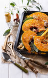 Cooking pumpkin with herbs and spices Stock Photos