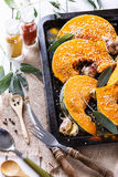 Cooking pumpkin with herbs and spices Royalty Free Stock Photos