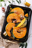 Cooking pumpkin with herbs and spices Royalty Free Stock Image