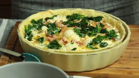 Cooking quiche recipe stock footage