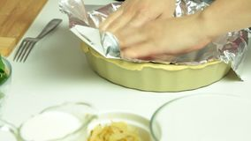 Cooking quiche recipe. Cooking quiche food recipe in the kitchen closeup stock video footage
