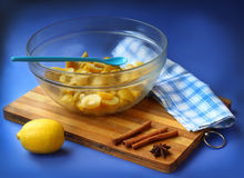 Cooking of quince jam and lemon. Quince  covered sugar and  lemon on a dark blue background Stock Images