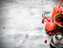 Cooking raspberry juice. On a black wooden background Royalty Free Stock Photography