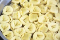 Cooking ravioli, fresh pasta Italian Cooking in water. Stock Image