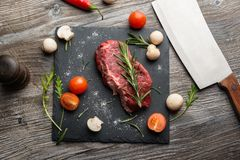 Cooking raw beefsteak Royalty Free Stock Photo