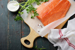 Cooking raw salmon Royalty Free Stock Photo