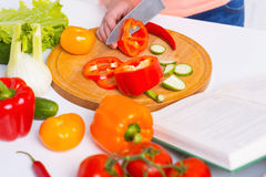 Cooking by recipe from cookbook. Stock Images