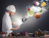 Cooking recipe from tablet. Chef reads a recipe from the tablet Stock Image