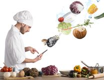 Cooking recipe from tablet. Chef reads a recipe from the tablet stock photography