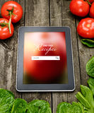 Cooking recipes on tablet pc Royalty Free Stock Photos