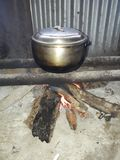 Cooking Rice. Using firewood, the Filipino traditional way royalty free stock image