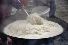 Cooking the rice on a large scale. Outdoor kitchen. Chinese village. Wedding feast Stock Photo