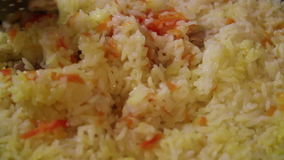 Cooking of rice stock video footage
