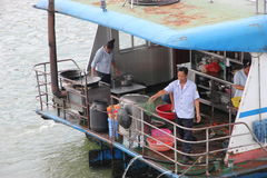 Cooking on the river. People cook on the boat during the cruise on the Li river, Guilin - China stock images