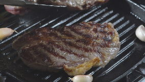 Cooking roast beef. The meat in a frying pan. stock video footage