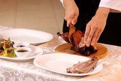Cooking roast duck in restaurant. Cooking a delicious roast duck with spices in restaurant Stock Photos